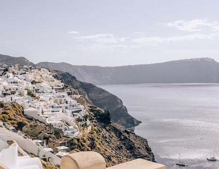 White mountainside homes looking over the caldera of Santorini, Greece