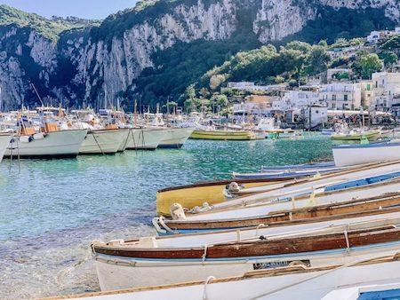 Various boats lined up and docked at Marina Grande in Capri, Italy
