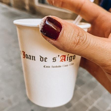 Cafe con leche to go from Can Joan de sAigo Cafe