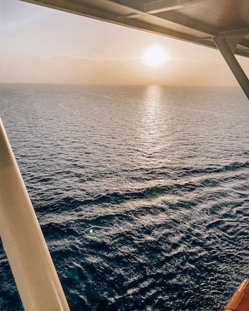 View of ocean and sunset from balcony of Celebrity Cruise