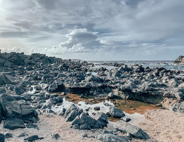 Lava rocks at beach in Arikoki National Park