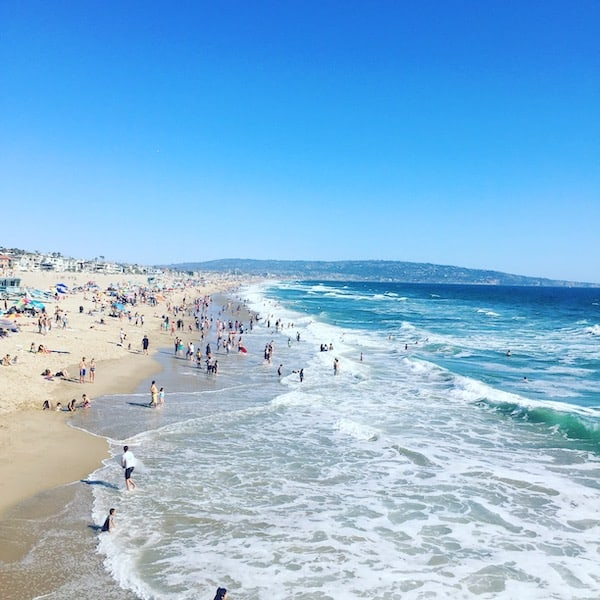 People frolicking at the shores of Manhattan Beach, California