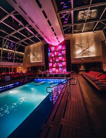 Cruise ship solarium pool lit up at night