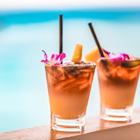 a couple of mai tai cocktails