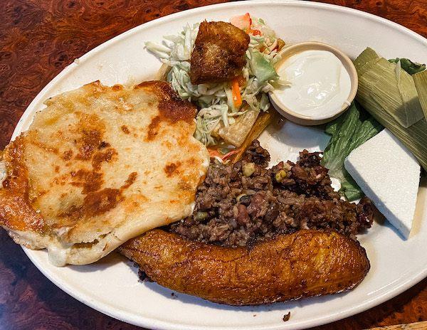 salvadorian cuisine of rice beans, sweet plantain, pupusas