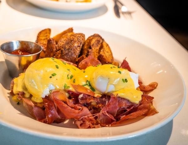 eggs benedict with proscitto and crispy potatoes